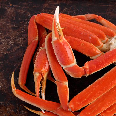 Crab legs on brown background photo