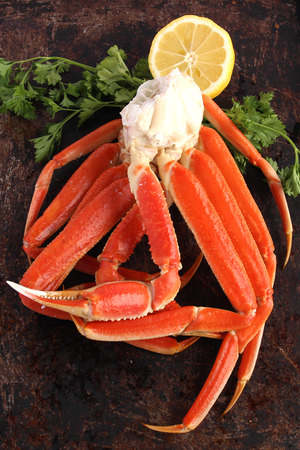 animal leg: Crab legs on brown background