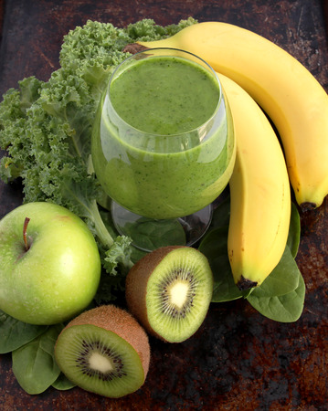 Green smoothie made with spinach, kale, kiwi, green apples and bananas photo