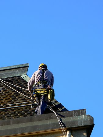 A man on a roof
