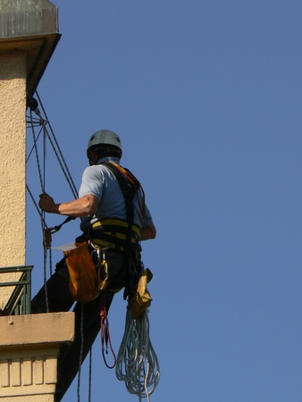 rappelling: man suspended and sky blue