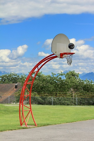 basketball hoop and sky and grass green