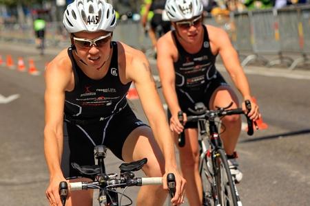 GENEVA, SWITZERLAND - JULY 24 : one unidentified male racing cyclist after the swimm race at the international Geneva Triathlon, on july 24, 2011 in Geneva, Switzerland