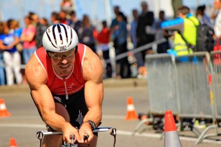 swimm: GENEVA, SWITZERLAND - JULY 22   one unidentified male racing cyclist after the swimm race at the international Geneva Triathlon, on july 22, 2012 in Geneva,