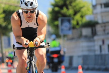 GENEVA, SWITZERLAND - JULY 22   one unidentified male racing cyclist after the swimm race at the international Geneva Triathlon, on july 22, 2012 in Geneva,