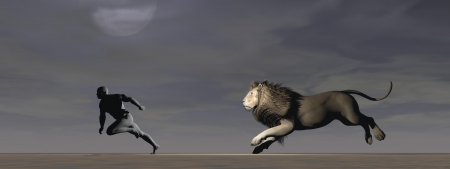 A man runs away pursued by a lion photo