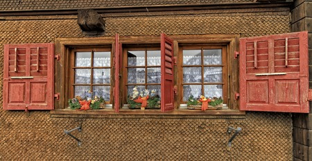 chalet: Chalet with shutters red and Christmas decorations