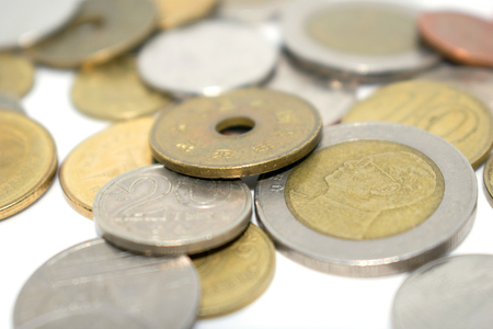 A photo of a large number of coins of different states. On a light background.