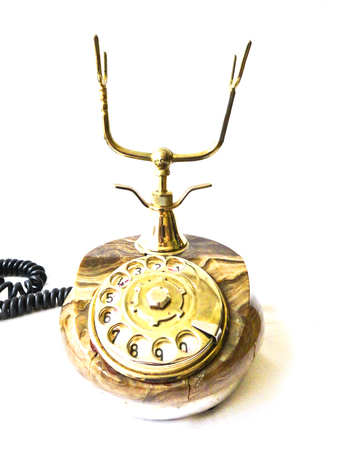 Old retro phone. Photo of an old telephone on a white background.