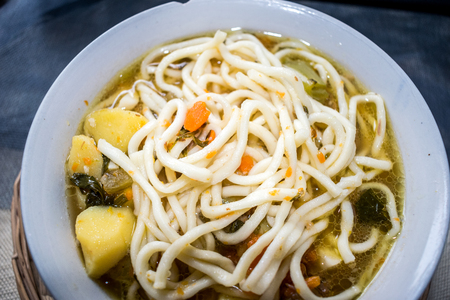 Uzbek national dish Lagnan. Noodles with gravy from meat, potatoes, greens, pepper.