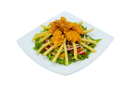 Chicken nuggets with french fries, greens on a plate. On a white background. Zdjęcie Seryjne