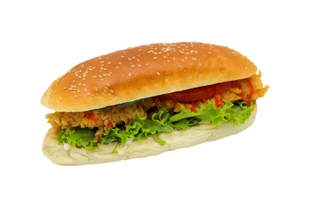 Hamburger with chicken nuggets, herbs, tomatoes in a bun. On a white background.