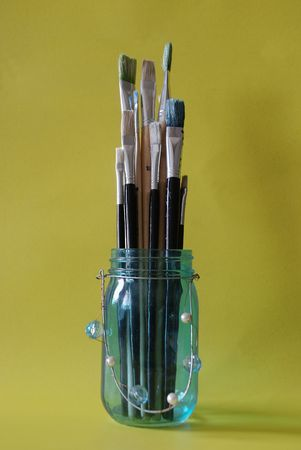 Paint brushes in a bottle photo