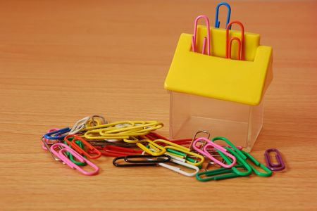 Paper clips with a container photo