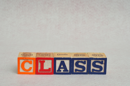 spelled: The word class spelled with colorful alphabet blocks isolated on white background Stock Photo