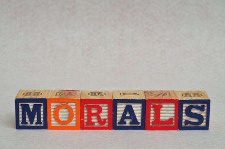 morals: The word morals spelled with colorful alphabet blocks isolated on white background