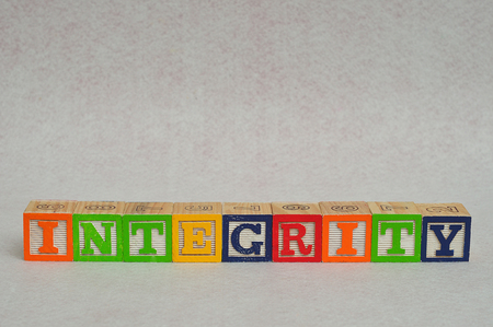 spelled: The word integrity spelled with colorful alphabet blocks isolated on white background