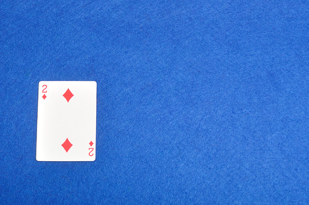diamonds isolated: Playing card. Two of diamonds isolated on a blue background