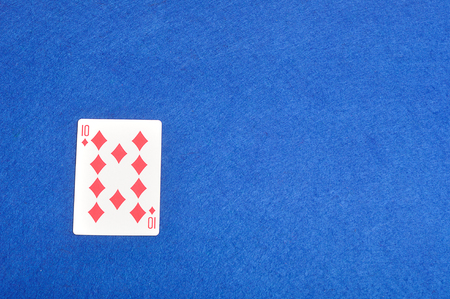 diamonds isolated: Playing card. Ten of diamonds isolated on a blue background