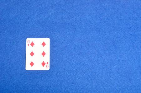 Playing card. Six of diamonds isolated on a blue background
