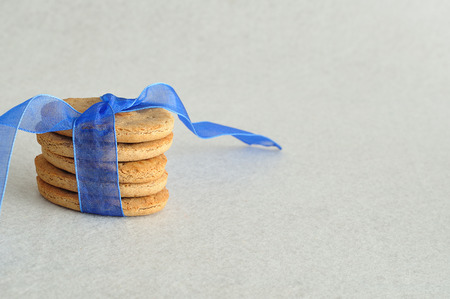 tied together: A stack of dog biscuits tied together with a blue ribbon Stock Photo