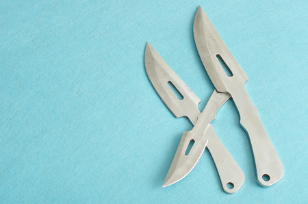 throwing knife: Combat knifes displayed on a blue background