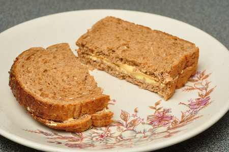 sandwich spread: A cheese spread whole wheat sandwich on a plate Stock Photo
