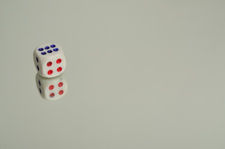 onto: A  dice that is reflection onto a white background