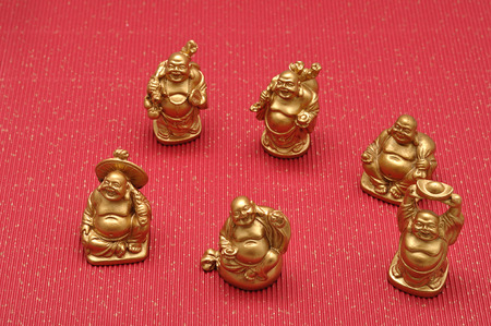 figurines: Figurines of laughing and cheerful golden Buddhas Stock Photo