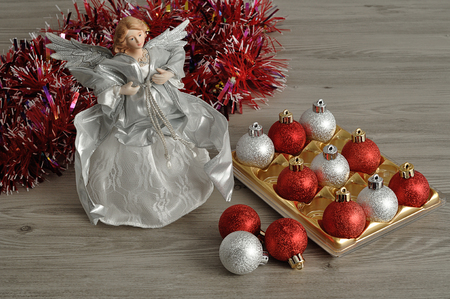 angel tree: An angel, garland and baubles to decorate a Christmas tree