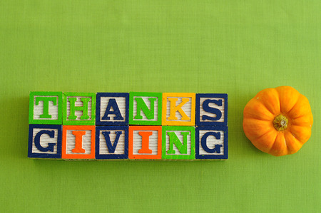 thanks giving: Thanks giving in colorful block displayed with pumpkins
