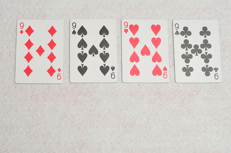 four of a kind: The different suit of the number 9 cards in a deck of cards displayed on a white background Stock Photo