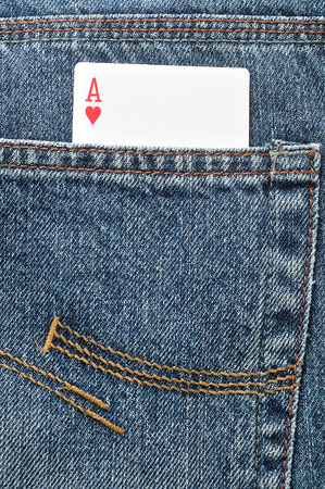 ace of hearts: An ace of hearts in the back pocket of a denim jeans pants Stock Photo