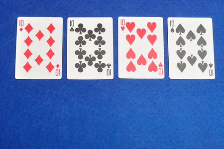 number 10: The different suit of the number 10 cards in a deck of cards displayed on a blue background