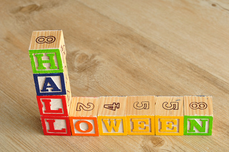 spelled: Halloween spelled with alphabet blocks