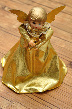 topper: An angel tree topper dressed in a gold dress