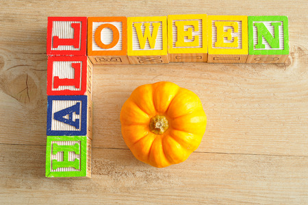 spelled: Halloween spelled with alphabet blocks with pumpkin