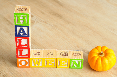 alphabet blocks: Halloween spelled with alphabet blocks with pumpkin