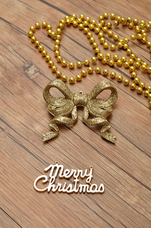 christma: Merry Christmas text, beads and glitter bow