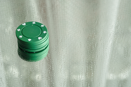 water stained: A stack of poker chips reflecting in a mirror that is stained with water drops Stock Photo