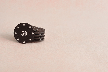 gamblers: Black poker chips with the value 50 on it