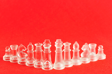 Different chess pieces displayed on a red background