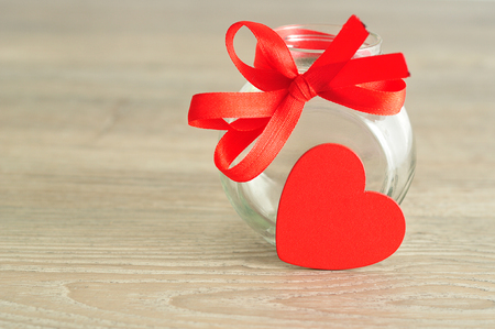 empty jar: An empty jar with a red ribbon displayed with a black heart