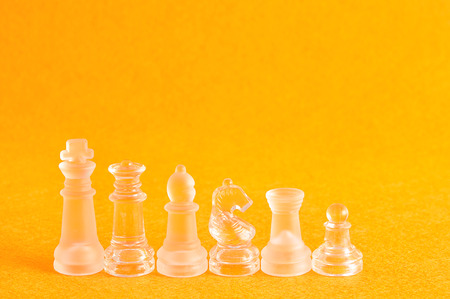 Different chess pieces displayed on a yellow background