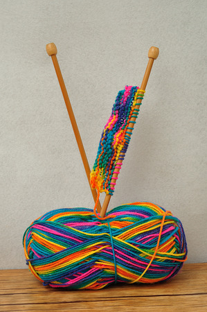 ball of wool: A ball of wool and knitting needles