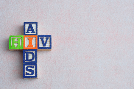 decease: The words aids and hiv spelled with colorful blocks isolated on a white background Stock Photo