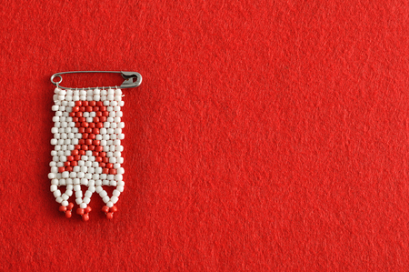 An aids ribbon as a bead work pin isolated