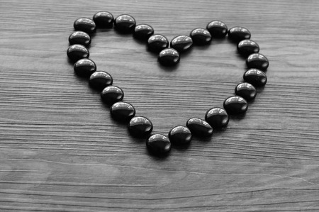 loveheart: Heart make out of black pebbles Stock Photo