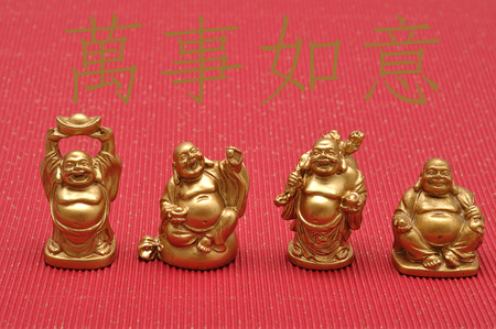 fulfilled: Chinese New Year design. Laughing cheerful Buddha isolated against a red background. Translation :  May all your wishes be fulfilled
