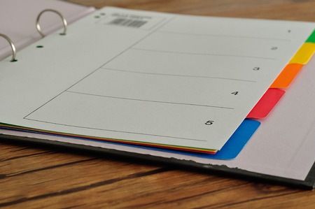 tab: Index divider cards in an open file. Number one to five colorful Stock Photo